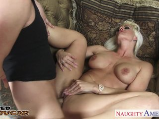 Blonde cougar Holly Heart sucking a fat shaft