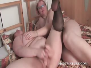 Mature BBW lesbos making out in bed