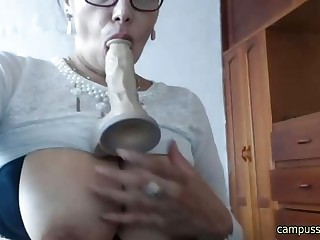 Hot grown-up fucking and sucking dildo on webcam