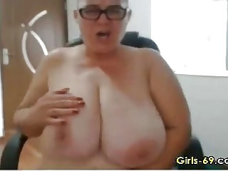 Fat Mature wigggling the brush big boobies live greater than webcam