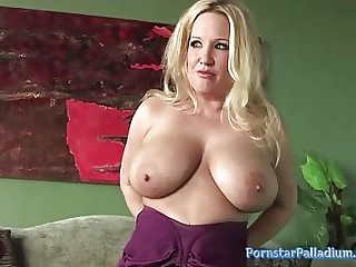 Rachel pleasures herself with a dildo identically withdraw some gargantuan milf boobs added to matured pussy