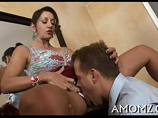 Horny mature is enthusiastic on touching schlong