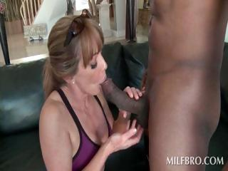 Sexy cougar blowing a big black shaft
